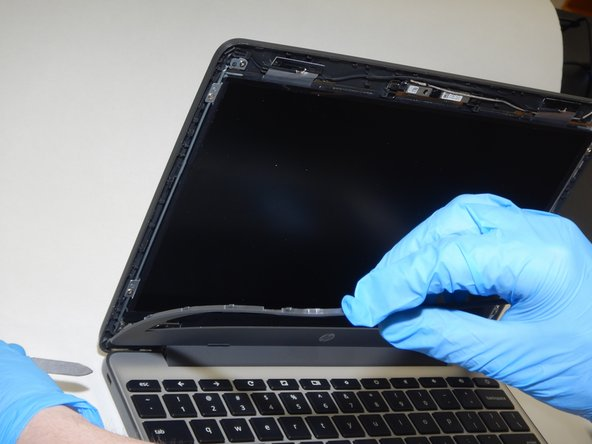 With the help of your spudger completely remove the plastic cover from the rest of the case.
