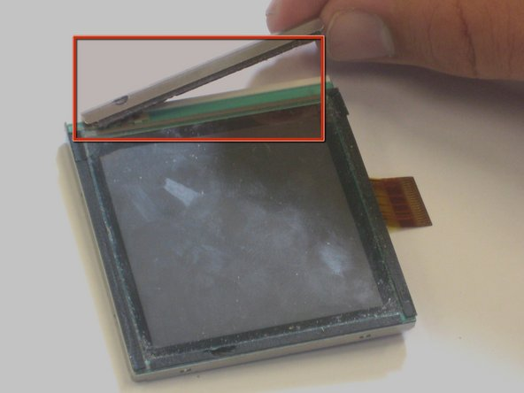 Flip the screen over a 180 degrees and take off the metal piece that cushions the screen.