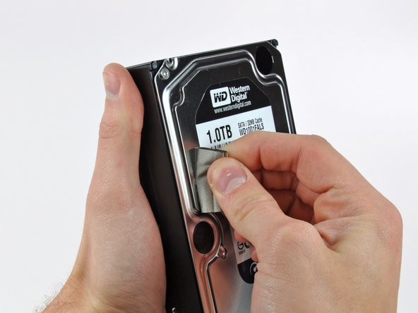 Carefully peel off the piece of EMI foam attached to the front of the hard drive.