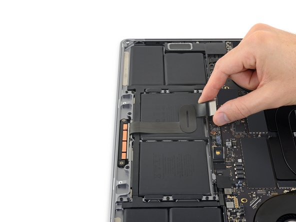 Carefully peel the trackpad cable up off the battery, and push it out of the way.