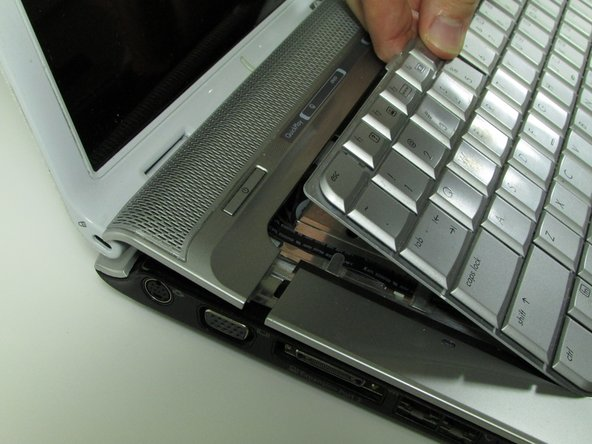 Pull out and up on keyboard to remove it.