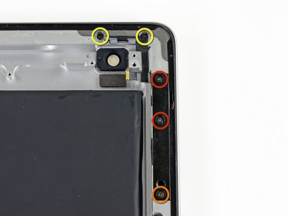 Remove the following screws securing the power & volume button cable to the aluminum frame: