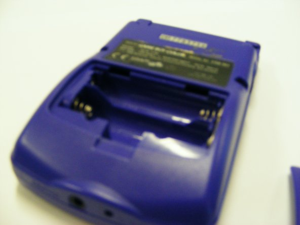 Remove the Game Boys battery case from the back of the game boy and take out any batteries that are inserted. this will leave you with the back panel.