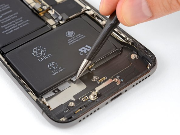 Repeat the above step to separate the remaining two adhesive tabs from the bottom edge of the battery.