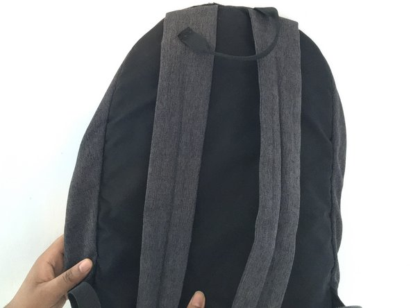 Use a pair of scissors to open the seam on the backpack where the grab handle was torn off.