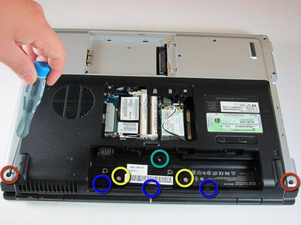 Remove the two 11.0mm screws at the corners on either side of the battery compartment. (shown by the red circles)