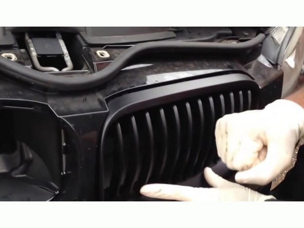 Use your hand to apply a bit of pressure to pop the new LED M-stripe kidney grille in place