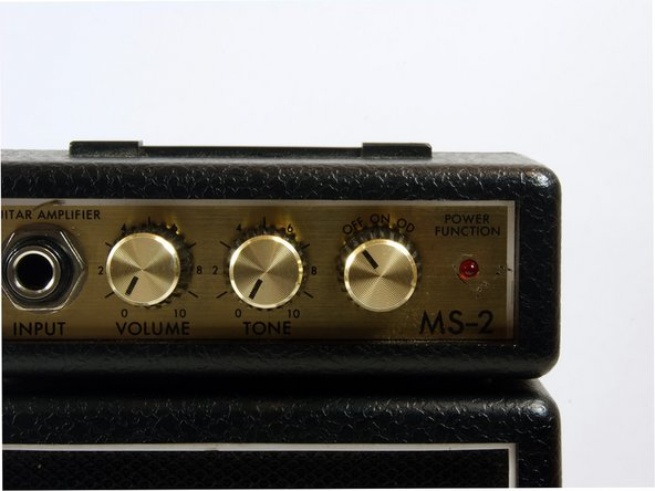 Remove the volume, tone and power knobs by pulling them straight away from the front of the device. If they do not come off easily use the wedge tool to pry them up.