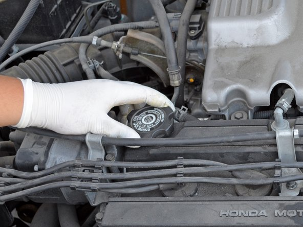 Locate the oil filler cap. It is on the passenger side of the valve cover, towards the rear.