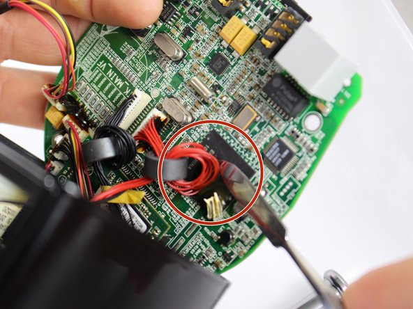 Separate the wire from CPU by cutting adhesive with metal spudger.