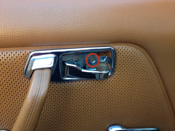 Attach the trim piece into position (this requires you maneuver the handle through it, take your time, some cars are easier than others).