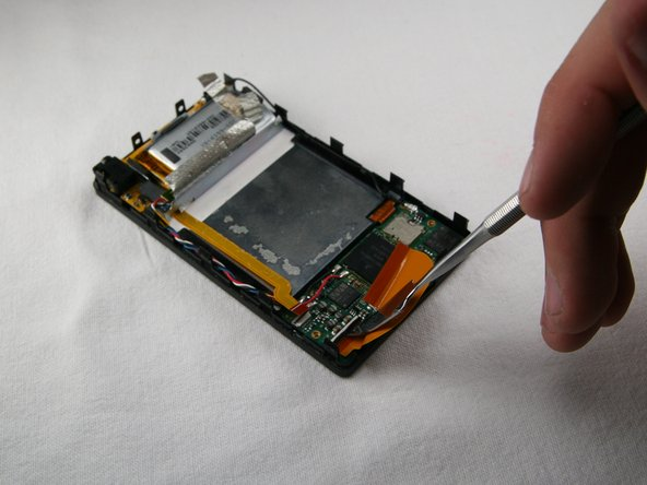 Flip the black bar to unclip the left side of the hard drive cable.  You may now remove the hard drive cable.