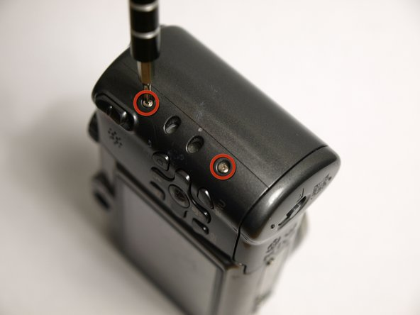 Remove the two screws located on the other side of the camera using a magnetic screwdriver