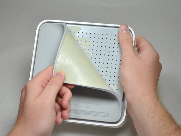 To avoid ripping the back pad, gently peel it back from one corner until the pad is completely off.