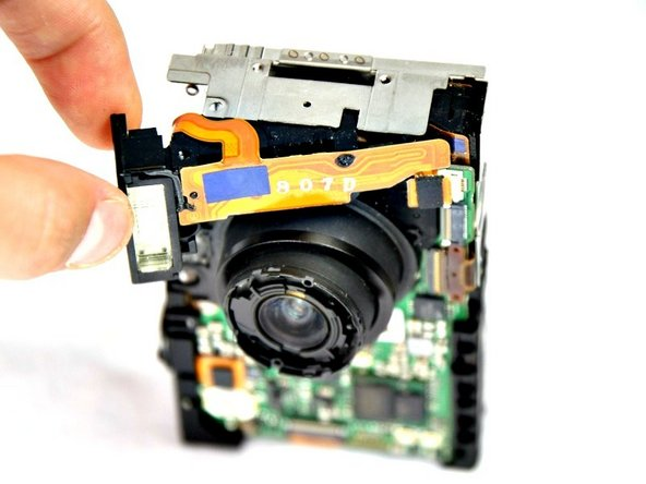 Pull the flash assembly forward out of the camera to remove it.