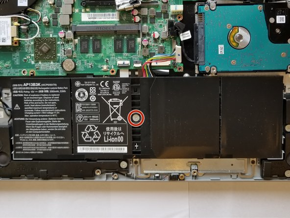 Remove the PH #0 screw from the center of the battery.