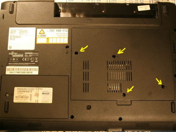 Remove the 4 philips screws that secure the back cover.