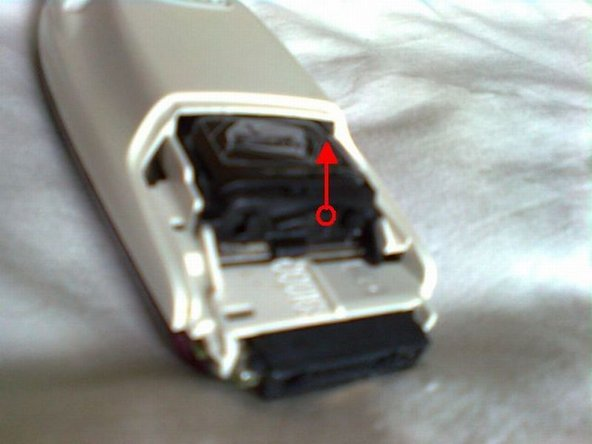 The battery itself, however, has a weird mechanism that must be first pulled up by the side (as shown in the first picture) and then, when the  switch is in the possition shown in the second picture, pulled out by the plastic side.