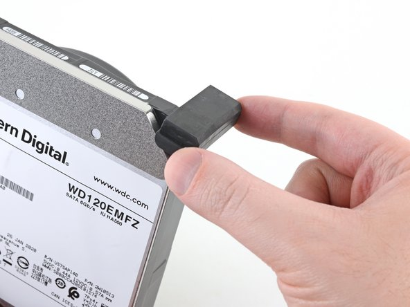 Remove the rubber blocks from the hard drive if they're still attached—some of them may have already fallen off when you removed the hard drive.
