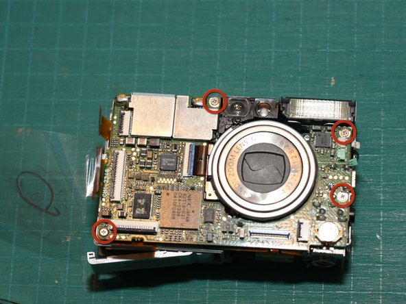 Remove the 4 screws holding the main logic board to the rest of the camera.