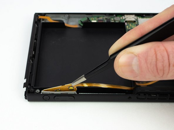 Remove the power/volume board with a pair of blunt nose tweezers.