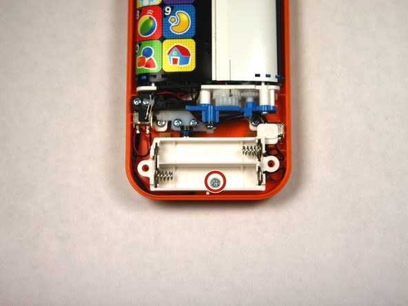 Remove a single 4.8 mm screw with a Phillips #0 screwdriver and lift away the battery pack being careful of the wires.