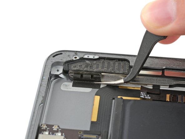 Carefully peel the LCD buffer tape up off of the rear case.