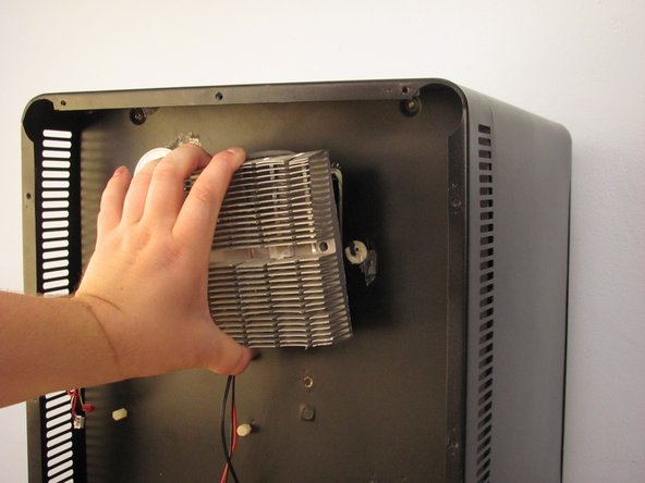 Remove heat sink slowly to avoid breaking cold sink fan cable.