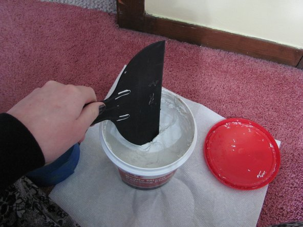 Dip the chisel scraper into the patching plaster, and begin to fill the hole. Use a gentle pressing motion to fill. Press multiple layers of the plaster until the entire hole is filled.