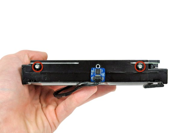 Remove the two 9.2 mm T8 Torx pins from the other side of the hard drive.