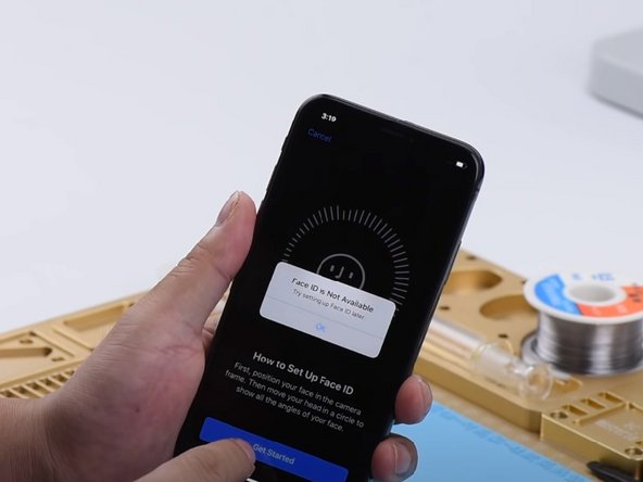 The iPhone X shows an alert that says it is 'unable to activate Face ID on this iPhone'.
