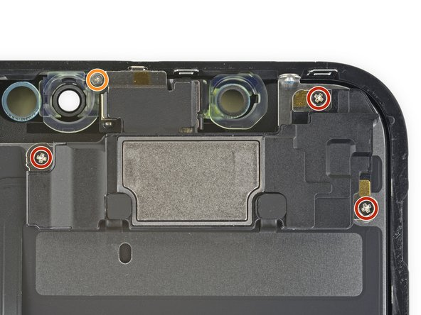 Remove four screws securing the speaker/sensor assembly: