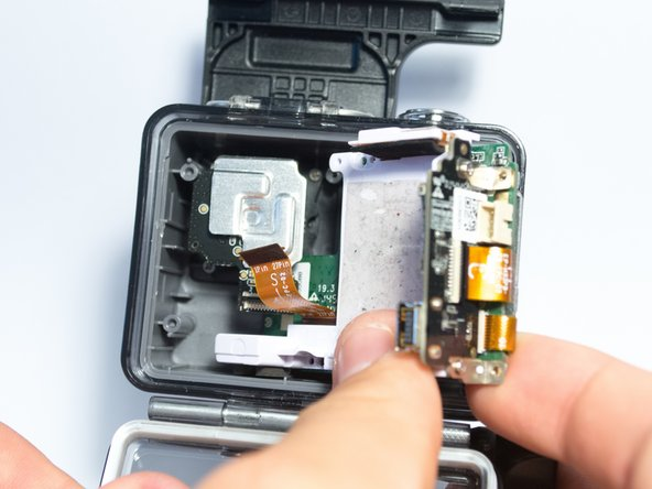 Carefully remove the motherboard and white plastic piece from the case.