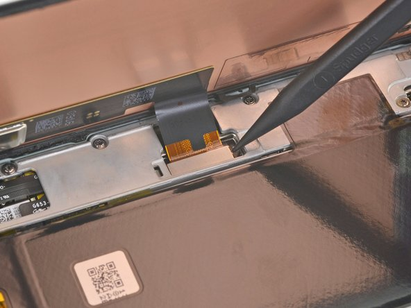 Use the tip of the spudger to pry up and disconnect the screen flex cable.