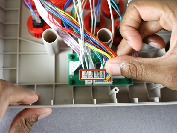 Locate the joystick wires that are attached to the four indicated plugs on the motherboard, and remove them.
