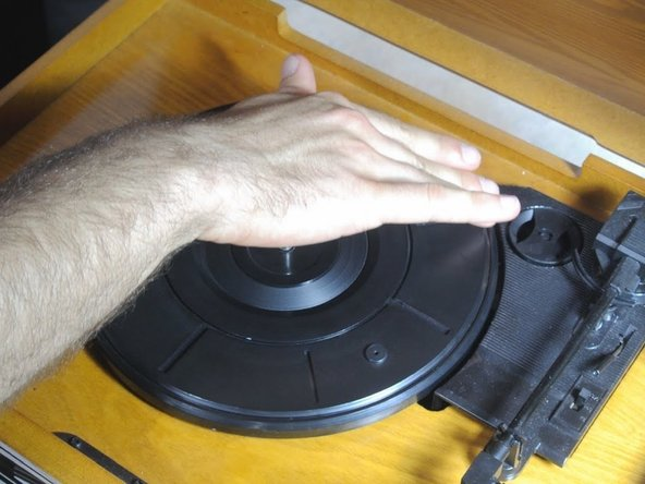 After the turntable is back on the device, gently turn it clockwise until you hear a 'click.'