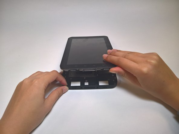 Holding the bottom of the device, lift the front panel from the back panel.