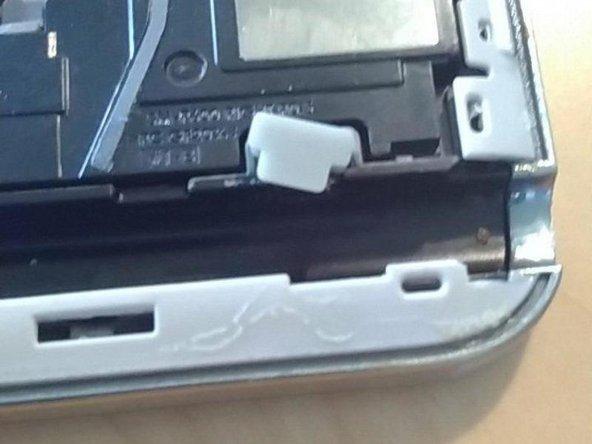 Remove the gray rubber piece.