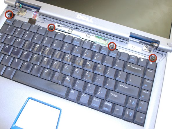 Using a Phillips screwdriver remove the four M2 x 3-mm screws holding in the keyboard.
