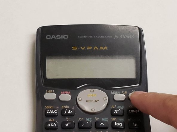 Flip the calculator on its back and press the 'ON' button to power it up.