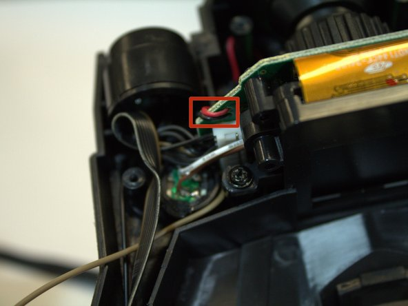 Find the connection of the red and black wires to the circuit board behind the LED screen.