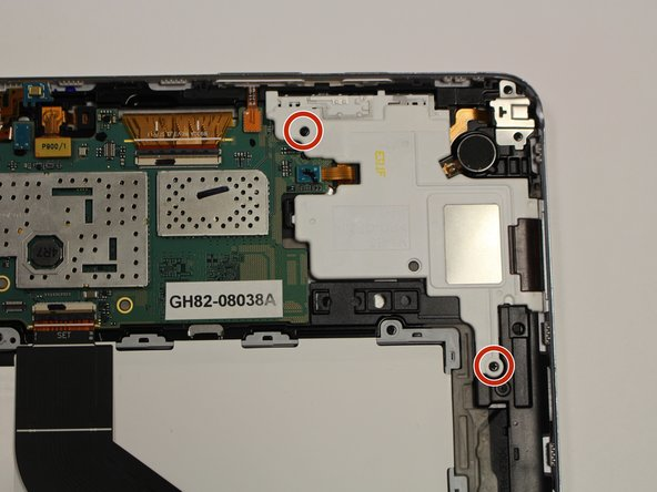 Remove the two 3mm Phillips #00 screws securing in the white cover over the audio jack.