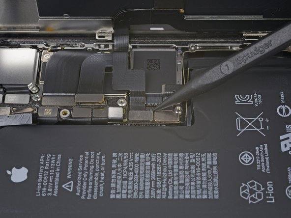 Use a spudger or fingernail to pry the digitizer cable connector up from its socket.