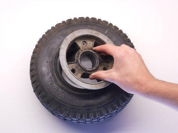 Flip the tire so that the bottom side is on the top now.