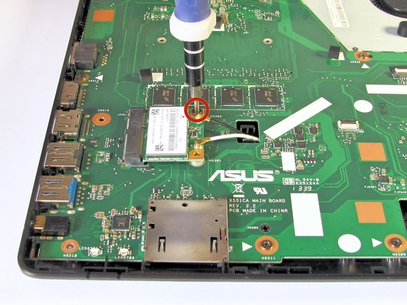Use the Phillips #0 Screwdriver to unscrew the 3.2 mm Phillips #0 screw which attaches the WiFi card to the motherboard.