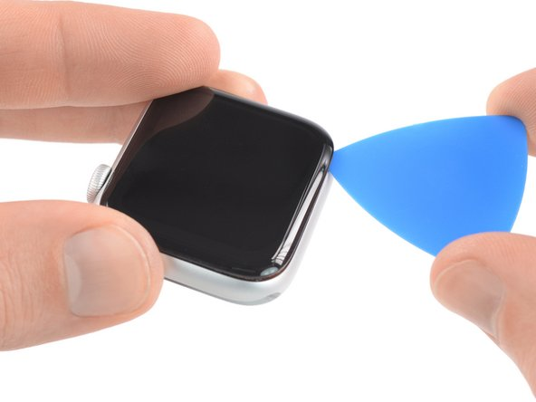 Place the watch on a flat surface and use an opening pick to slice through any remaining adhesive.