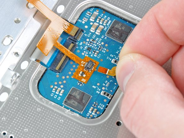 Pull the mouse button ribbon cable out of its socket.