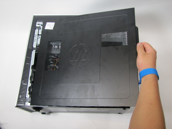 Remove the side panel by sliding it towards the back of the desktop and pulling up on it as shown.