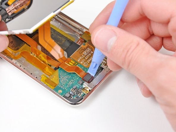 Use an iPod opening tool to pry the display data cable connector up off its socket on the logic board.