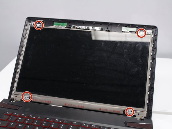 Using the Phillips #0 screwdriver, remove the four 8mm screws from each corner of the screen.